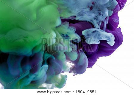 colorful ink. a purple blue drop swirling under water. Cloud of ink in water. abstract background