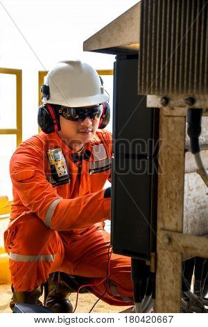 TechnicianInstrument technician on the job calibrate or function check pneumatic control valve in process oil and gas platform offshoretechniciantechniciantechniciantechniciantechnician