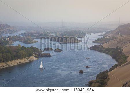 Feluccas Sailing On The Nile Near Aswan, Egypt