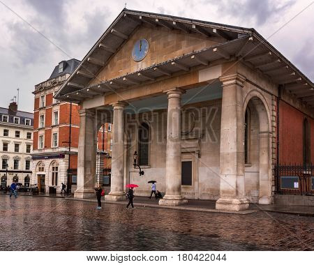 LONDON UNITED KINGDOM - OCTOBER 6 2014: Saint Paul's Church in Covent Garden London. St Paul's Church also known as the Actors' Church is designed by Inigo Jones in 1631.