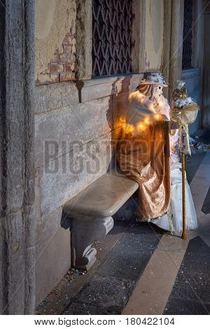 VENICE ITALY - FEBRUARY 7 2016: White Dressed Mask Figure in Venice Italy. The Venice Carnival ends with the Christian celebration of Lent forty days before Easter