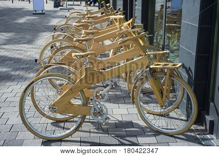 Bike sharing station in perspective with special wood model