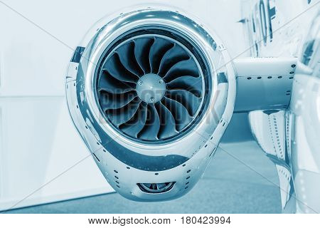 detailed insigh tturbine blades of an aircraft jet engine colored technical blue business jet engine close up high detailed view