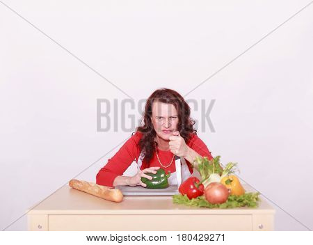 a Cut angry Lady with the vegetables