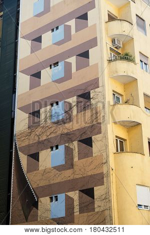 MADRID, SPAIN - JULY 17, 2016: Madrid (Spain): historic building with trompe-l'oeil near Plaza Mayor