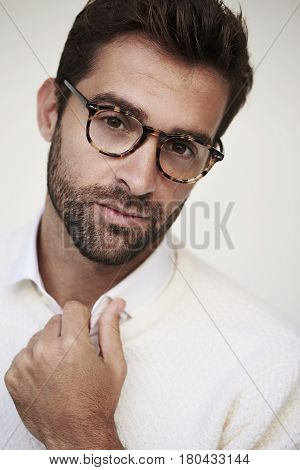 Guy with glasses and stubble portrait studio shot