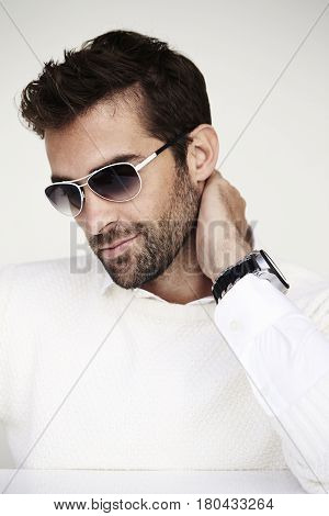 Sunglasses and stubble on guy in white