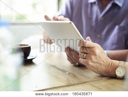Closeup couple hands using tablet