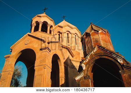 Photo of the Katoghike Holy Mother of God Church and Saint Anna Church. Armenian architecture. Yerevan City center, Armenia. Religious background. Travel concept.
