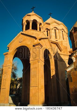 Photo of the Katoghike Holy Mother of God Church and Saint Anna Church. Armenian architecture. Yerevan City center, Armenia. Religious background. Travel concept. Vertical. Arches