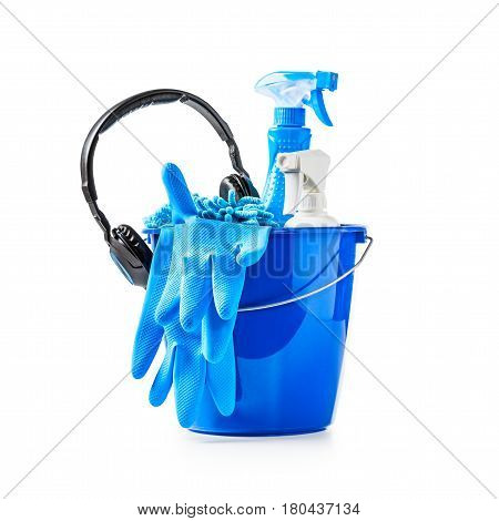 Blue bucket with cleaning supplies and music headphone isolated on white background. Single object with clipping path