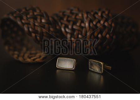 Male belt with cuff in black background