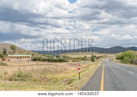 JAGTPOORT SOUTH AFRICA - MARCH 21 2017: A landscape with road stall next to the N9 road between Middelburg and Graaff Reinet in the Eastern Cape Province
