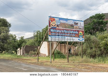 NIEU BETHESDA SOUTH AFRICA - MARCH 21 2017: A welcome sign and ruin at the entrance to Nieu-Bethesda an historic village in the Eastern Cape Province