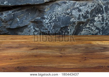 Natural Rustic Reddish Brown Wood With Exotic Natural Stone Wall As Background