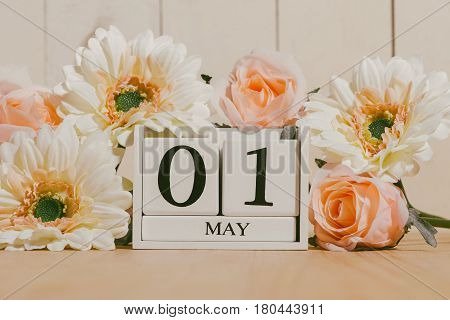 May 1St. Image Of May 1 White Block Calendar On White Background With Flowers. Spring Day, Empty Spa