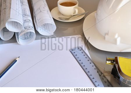 Working Table Of Construction Engineer With New Project Closeup Elevated