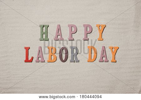 Happy Labor Day On The Sandy Beach Background. Happy Labor Day Word In Colorful Stones
