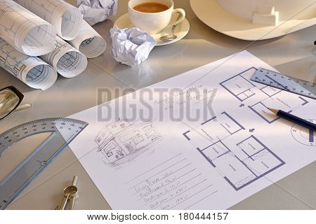 Working Table Of Construction Engineer With Plan Of Project Elevated