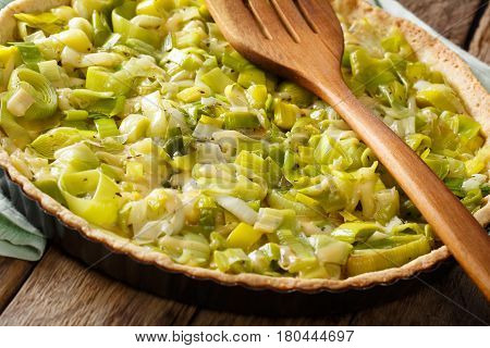 Delicious Savory Leek Flan With Cheese Close-up. Horizontal