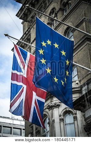 European and British flags together outside grand building