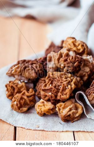 Fresh mushrooms morel on linen tablecloth and wooden table.