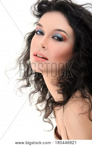 Attractive young woman with wavy long hair wearing colorful makeup smiling to the camera isolated on white artistic creative visage cosmetics face beauty fashionable stylish glamorous beauty industry.