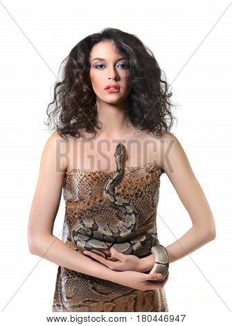 Vertical studio portrait of a beautiful young brunette girl wearing colorful creative makeup holding a snake posing sensually isolated on white beauty fashion courage exotic reptile sexy sensuality.