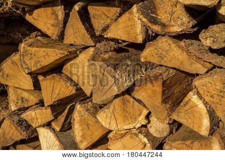 Stack Of Firewood - Wooden Abstract Background. Outdoor Rack With Firewood Logs.