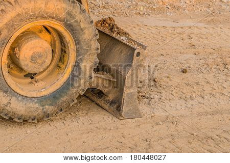 Closeup of tire and rim of earth moving equipment at a construction site in South Korea