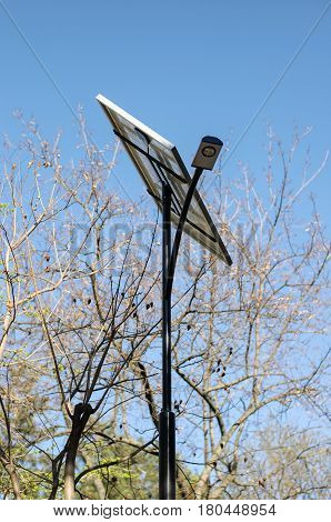 A streetlight with solar panel and lamppost