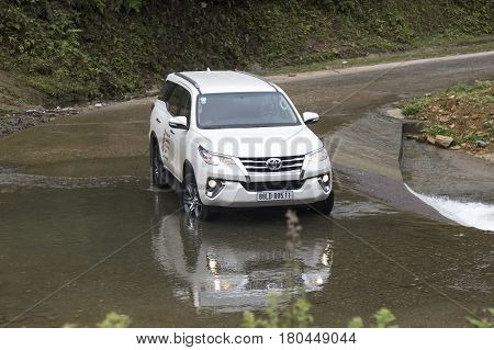 Lao Cai, Vietnam - Mar 17, 2017: Toyota Fortuner 2017 SUV in a test drive for ability on multi terrains in the far north of Vietnam.