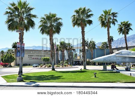 PALM SPRINGS, CALIFORNIA - MARCH 24, 2017: Palm Springs Air Museum front view with plane. The Palm Springs Air Museum is home to one of the world??s largest collections of flyable WWII aircraft.