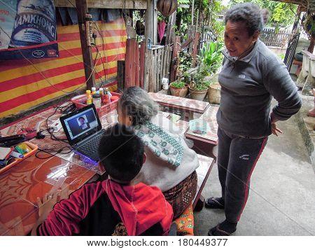 Grandmother Talking To Her Granddaughter Through Skype At Luang Prabang