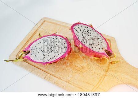 Exotic Fruit Pitaya Or Pitahaya, Dragon Fruit (hylocereus Undatus) On Wooden Board Isolated On White