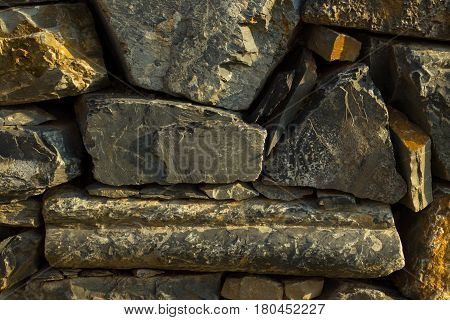 Artistic Texture Of A Rustic Vintage Brownish Stone Wall To Be Used As Background