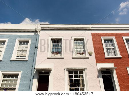 LONDON, UK - MAY 17, 2016: Colourful terraced houses of Notting Hill. Notting Hill is one of the most expensive residential areas in London