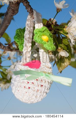 beautiful small knitted basket for Easter outdors