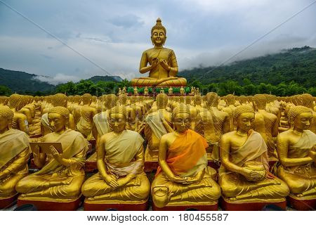 Buddha image with his discuple statues in Buddhism memorial park Nakornnayok Thailand