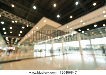 Public event exhibition hall blurred bokeh defocused background business trade show or modern interior architecture concept