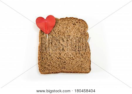 Whole Grain Sandwich Bread Slice With Heart Pin, On White Background.