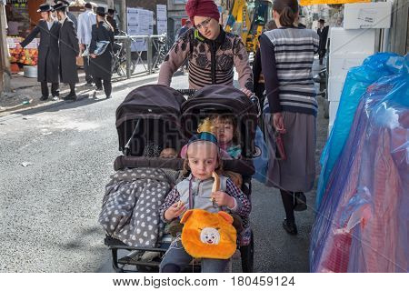 Orthodox Jewish Woman With Childs Walk In Jewish Quarter. Jerusalem. Israel