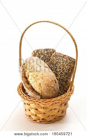 Whole Wheat Sandwich Buns With Seeds In Wicker Basket, On White Background.