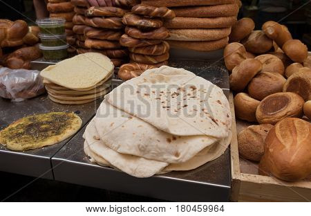 Fresh tradition iraqian bread and group of baked goods for sale at Mahane Yehuda Market popular marketplace in Jerusalem Israel