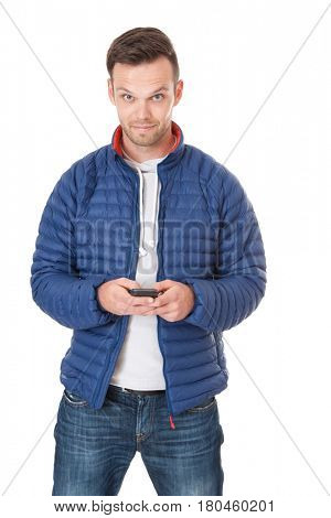 Attractive young man using smart phone. All on white background.