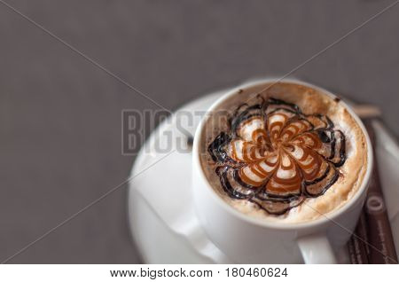 Cup Of Coffee And Cappuccino Art Latte