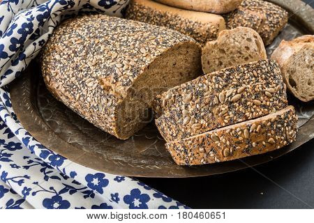 Whole Wheat Bread And Sandwich Buns, On Oriental  Dish With Floral Kitchen Towel