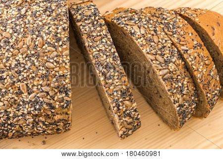 Whole Wheat Sliced Bread Closeup, On Wooden Surface.