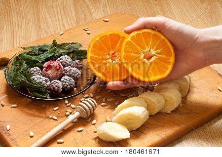 Cooking, Banana,hand Holding Orange,frozen Strawberries Blackberries And Seeds Vivid Smoothie Ingred