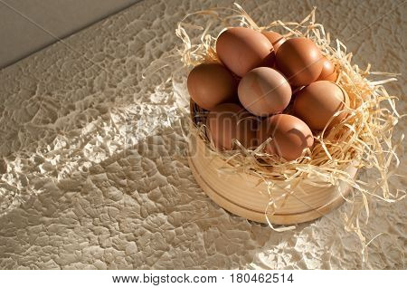 Easter Holiday. Sieve Full Of Easter Eggs On Rustic Wooden